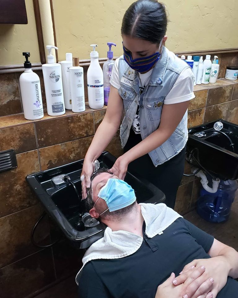 The beautiful Casey with her hair up giving somebody a shampoo and head massage in the sink. I'm jealous!